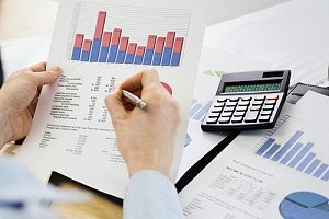 business owner looking over cash flow to determine eligibility for a business line of credit