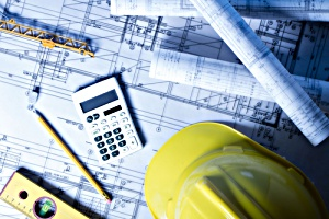 A business owner looking at architectural blueprint and evaluating construction costs