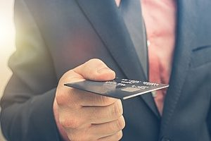 a business owner conducting business banking with his new company credit card