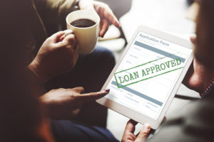 an online application for a business line of credit with an approval stamp on it