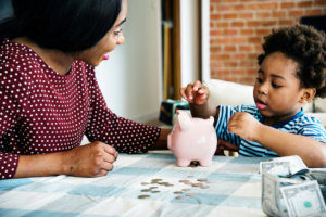 mother teaching her son how to save money
