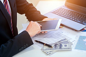 a business banker performing cash management services for a local business