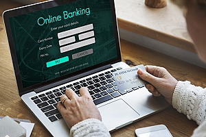 a business owner using secure online banking services